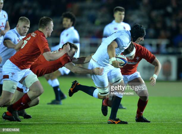 Sam Lewis of England is tackled by Car Evans of wales in the second half during the RBS Under 20's Six Nations match between England U20 and Wales...