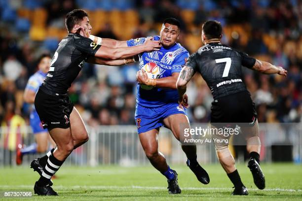 Sam Lisone of Samoa on the charge against Joseph Tapine and Shaun Johnson of the Kiwis during the 2017 Rugby League World Cup match between the New...