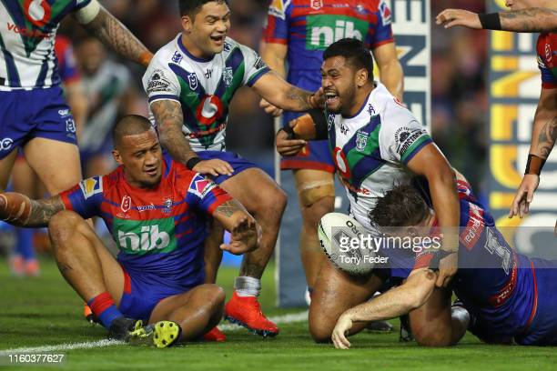 Sam Lisone of the New Zealand Warriors scores a try during the round 16 NRL match between the Newcastle Knights and the New Zealand Warriors at...