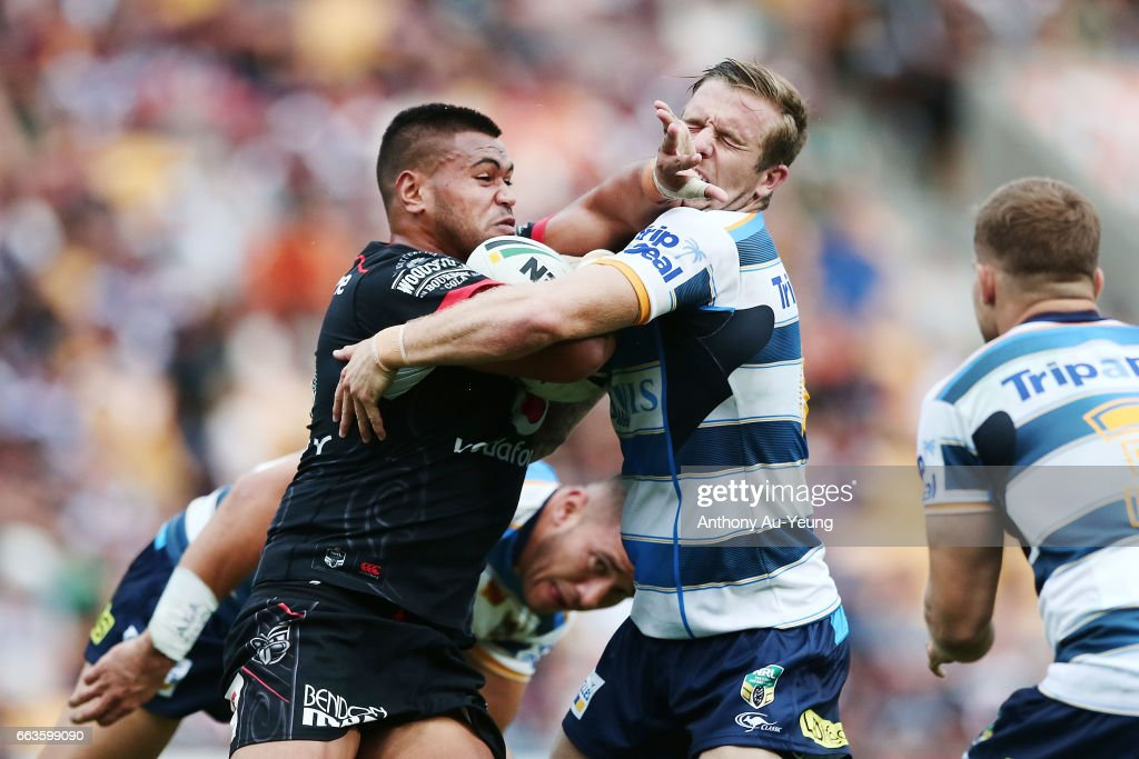 Sam Lisone of the Warriors fends against Kane Elgey of the Titans during the round five NRL match between the New Zealand Warriors and the Gold Coast Titans at Mt Smart Stadium on April 2, 2017 in Auckland, New Zealand.
