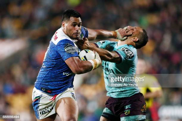 Sam Lisone of the Warriors fends off Benji Marshall of the Broncos during the round 12 NRL match between the New Zealand Warriors and the Brisbane...
