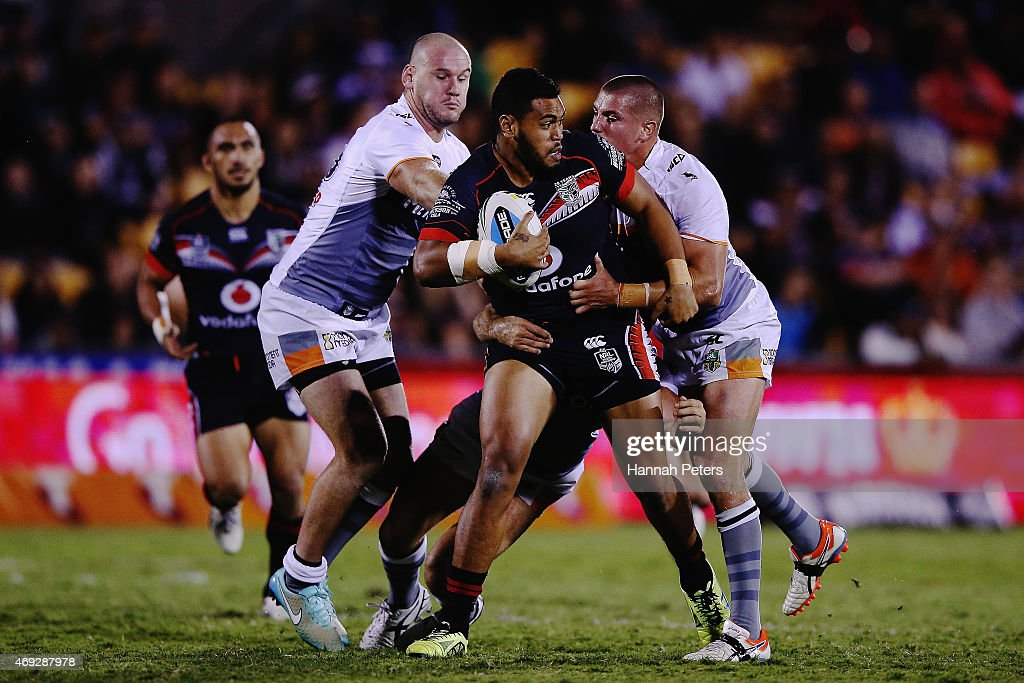 Sam Lisone of the Warriors looks to offload the ball during the round six NRL match between the New Zealand Warriors and the Wests Tigers at Mt Smart Stadium on April 11, 2015 in Auckland, New Zealand.