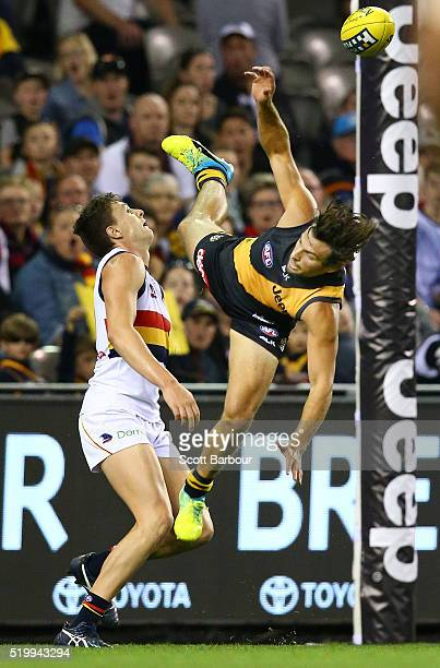Sam Lloyd of the Richmond Tigers attempts to take a spectacular mark over Jake Lever of the Adelaide Crows during the round three AFL match between...