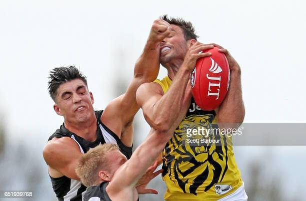Sam Lloyd of the Tigers and Brayden Maynard of the Magpies compete for the ball during the 2017 JLT Community Series AFL match between the Richmond...