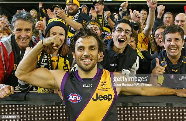 Sam Lloyd of the Tigers celebrates with Tigers supporters in the crowd after kicking the matchwinning goal after the final siren during the round...