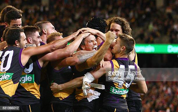 Sam Lloyd of the Tigers is congratulated by his teammates after kicking the matchwinning goal after the final siren during the round eight AFL match...