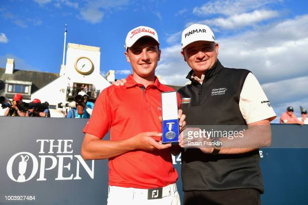Sam Locke of Scotland holds the Silver Medal awarded to highest placed amateur alongside former Champion Golfer of the Year Paul Lawrie of Scotland...