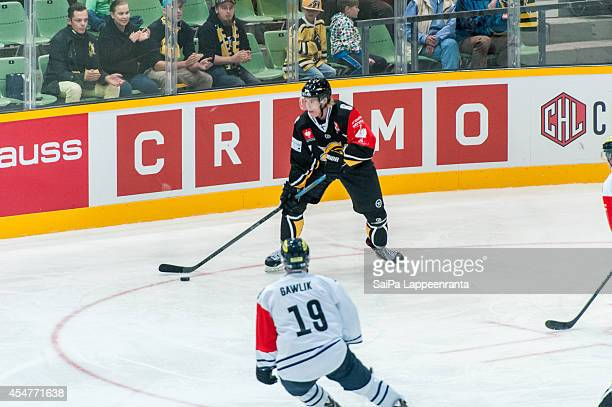 Sam Lofquist $6 of SaiPa and Christoph Gawlik of ERC Ingolstadt during the Champions Hockey League group stage game between SaiPa Lappeenranta and...