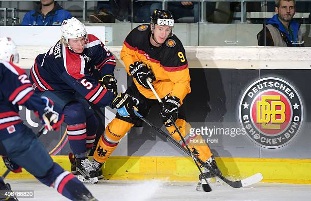 Sam Lofquist of Team USA and Jerome Flaake of Team Germany during the game between USA against Germany on november 8 2015 in Augsburg Germany