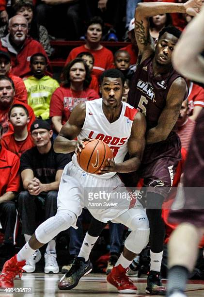 Sam Logwood of the New Mexico Lobos blocks out against Jamaal Samuel of the LouisianaMonroe Warhawks during their game at The WisePies Arena aka the...