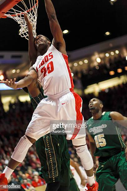 Sam Logwood of the New Mexico Lobos goes up for two points against JJ Avila and Tiel Daniels of the Colorado State Rams during their game at The...