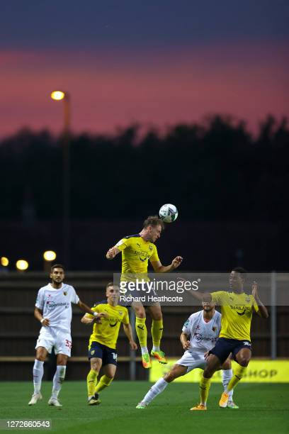 Sam Long of Oxford United wins a header during the Carabao Cup Second Round match between Oxford United and Watford FC at Kassam Stadium on September...