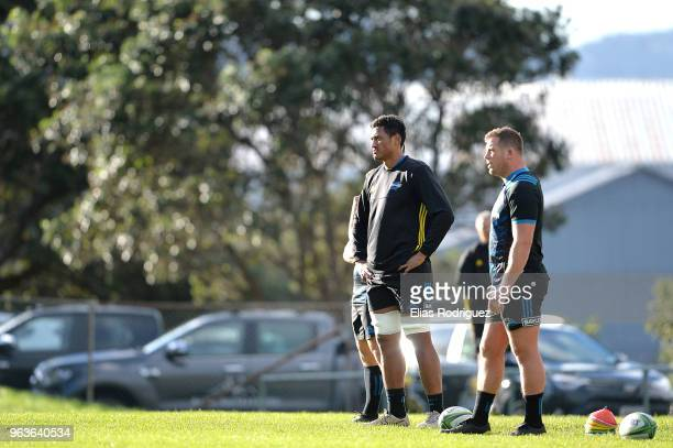 Sam Lousi and Murray Douglas watch team mates during a Hurricanes Super Rugby training session at Rugby League Park on May 30 2018 in Wellington New...