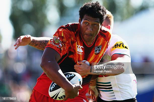 Sam Lousi of the Warriors charges forward during the NRL trial match between the New Zealand Warriors and the Penrith Panthers at Waikato Stadium on...