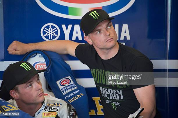 Sam Lowes of Britain and Feder Oil Gresini Moto2 and his twin Alex Lowes of Great Britain and PATA Yamaha Official WorldSBK Team look on in box...