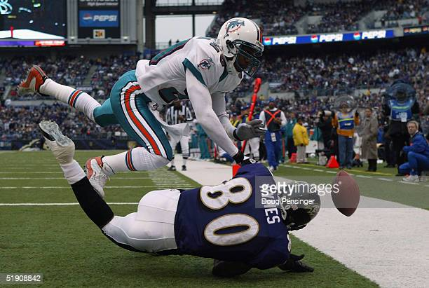 Sam Madison of the Miami Dolphins is called for pass interference in the end zone as he covers Randy Hymes of the Baltimore Ravens at M&T Bank...