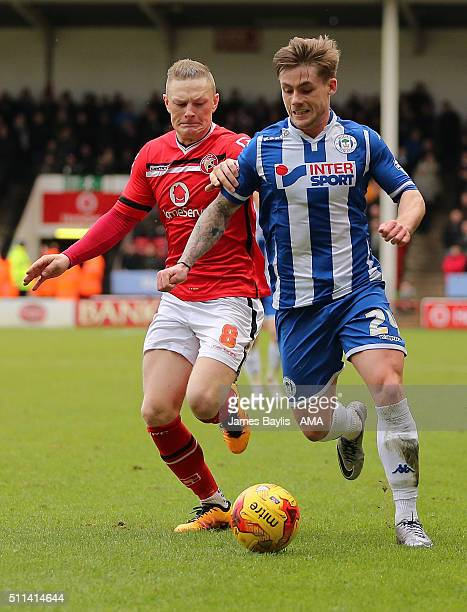 Sam Manton of Walsall and Conor McAleny of Wigan Athletic during the Sky Bet League One match between Walsall and Wigan Athletic at Bescot Stadium on...