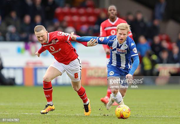 Sam Manton of Walsall and David Perkins of Wigan Athletic during the Sky Bet League One match between Walsall and Wigan Athletic at Bescot Stadium on...