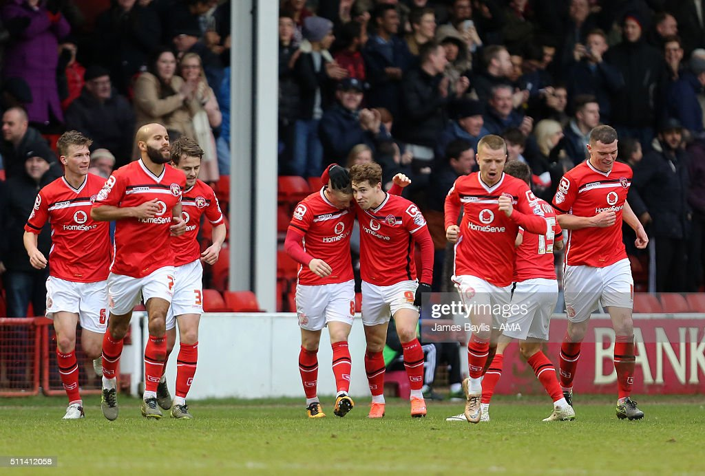 Sam Manton of Walsall celebrates with his team-mates after scoring a goal to make it 1-1 during the Sky Bet League One match between Walsall and Wigan Athletic at Bescot Stadium on February 20, 2016 in Walsall, England.