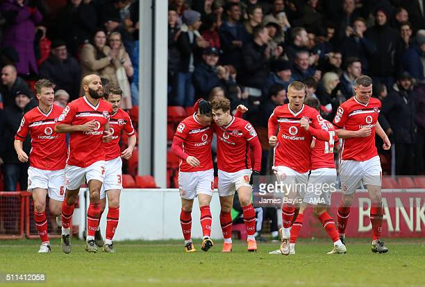 Sam Manton of Walsall celebrates with his teammates after scoring a goal to make it 11 during the Sky Bet League One match between Walsall and Wigan...