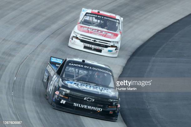 Sam Mayer, driver of the All Weather Armour Chevrolet, leads Carson Hocevar, driver of the Scott's Chevrolet, during the NASCAR Gander RV & Outdoors...
