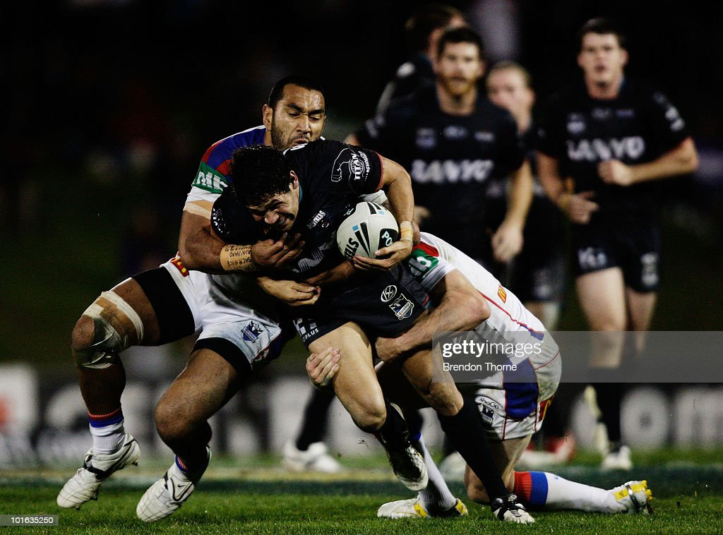 Sam McKendry of the Panthers is tackled by the Knights defence during the round 13 NRL match between the Penrith Panthers and the Newcastle Knights at CUA Stadium on June 5, 2010 in Sydney, Australia.