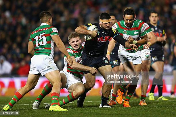 Sam McKendry of the Panthers is tackled during the round 17 NRL match between the Penrith Panthers and the South Sydney Rabbitohs at Pepper Stadium...