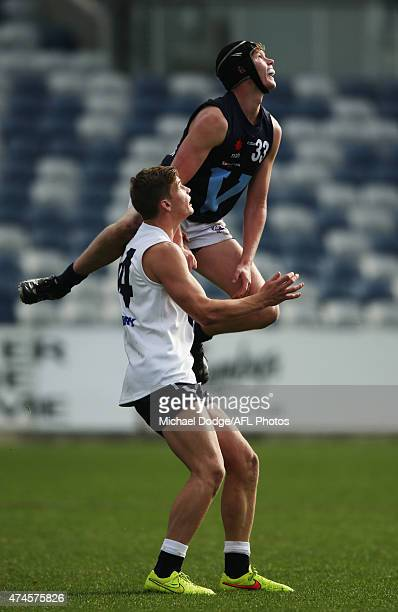 Sam Mclarty of Vic Metro leaps over Sam Skinner of Vic Country during the U18 Championship match between Vic Metro and Vic Country at Simonds Stadium...