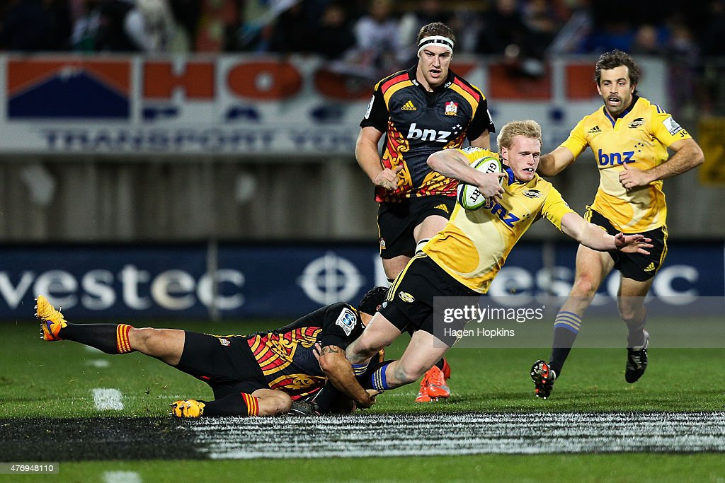 Sam McNicol of the Hurricanes is tackled during the round 18 Super Rugby match between the Chiefs and the Hurricanes at Yarrow Stadium on June 13, 2015 in New Plymouth, New Zealand.