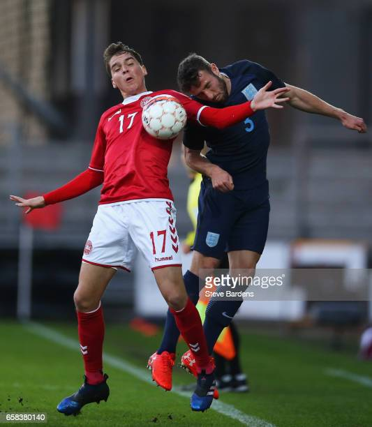 Sam McQueen of England and Robert Skov of Denmark battle for the ball during the U21 international friendly match between Denmark and England at...