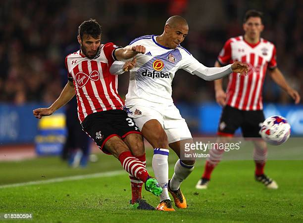 Sam McQueen of Southampton tackles Wahbi Khazri of Sunderland during the EFL Cup fourth round match between Southampton and Sunderland at St Mary's...