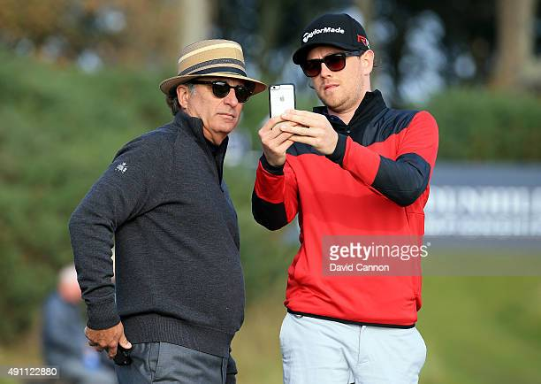 Sam McTrusty the Scottish rock star demonstates how to shoot a panoramic picture to Andy Garcia on the 12th tee during the third round of the 2015...