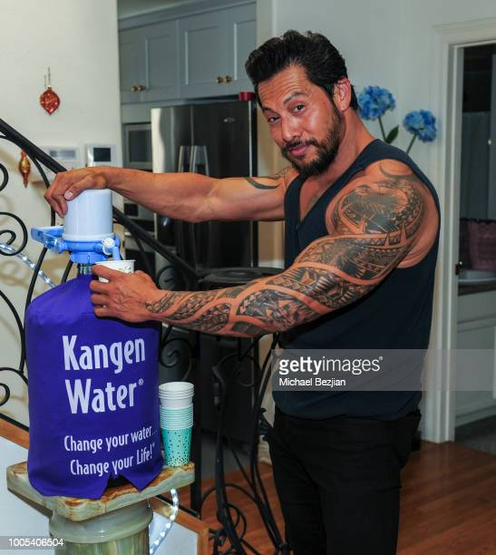 Sam Medina drinks Kangen water at Visual Snow Initiative Awareness Day at TAP The Artists Project on July 25 2018 in Los Angeles California