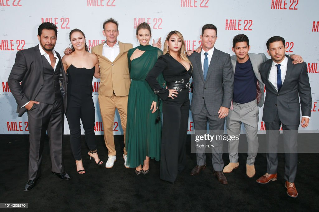 Sam Medina, Ronda Rousey, Peter Berg, Lauren Cohan, CL, Mark Wahlberg, Iko Uwais and Carlo Alban attend the premiere of STX Films' 'Mile 22' at Westwood Village Theatre on August 9, 2018 in Westwood, California.