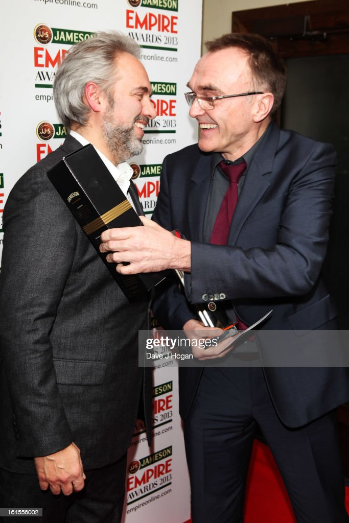 Sam Mendes and Danny Boyle pose in the press room at the Jameson Empire Awards 2013 at Grosvenor House Hotel on March 24, 2013 in London, England.