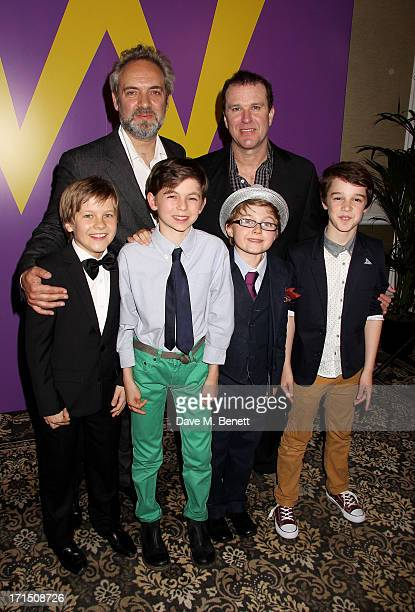 Sam Mendes and Douglas Hodge pose with Charlie actors Jack Costello Tom Klenerman Louis Suc and Isaac Rouse at an after party celebrating the press...
