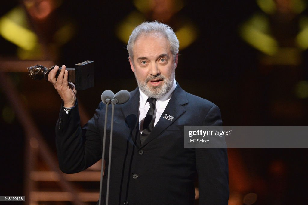 Sam Mendes receives the award for Best Director for 'The Ferryman' on stage during The Olivier Awards with Mastercard at Royal Albert Hall on April 8, 2018 in London, England.