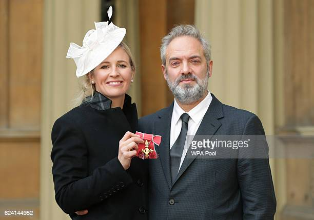 Sam Mendes with Alison Balsom after she received her OBE from the Prince of Wales during an Investiture ceremony at Buckingham Palace on November 18...