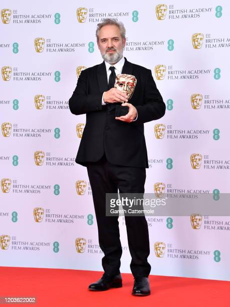 """Sam Mendes with the Best Director award for """"1917"""" poses in the Winners Room during the EE British Academy Film Awards 2020 at Royal Albert Hall on..."""
