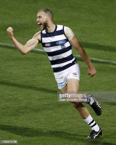 Sam Menegola of the Cats celebrates a goal during the 2021 AFL Round 05 match between the Geelong Cats and the North Melbourne Kangaroos at GMHBA...