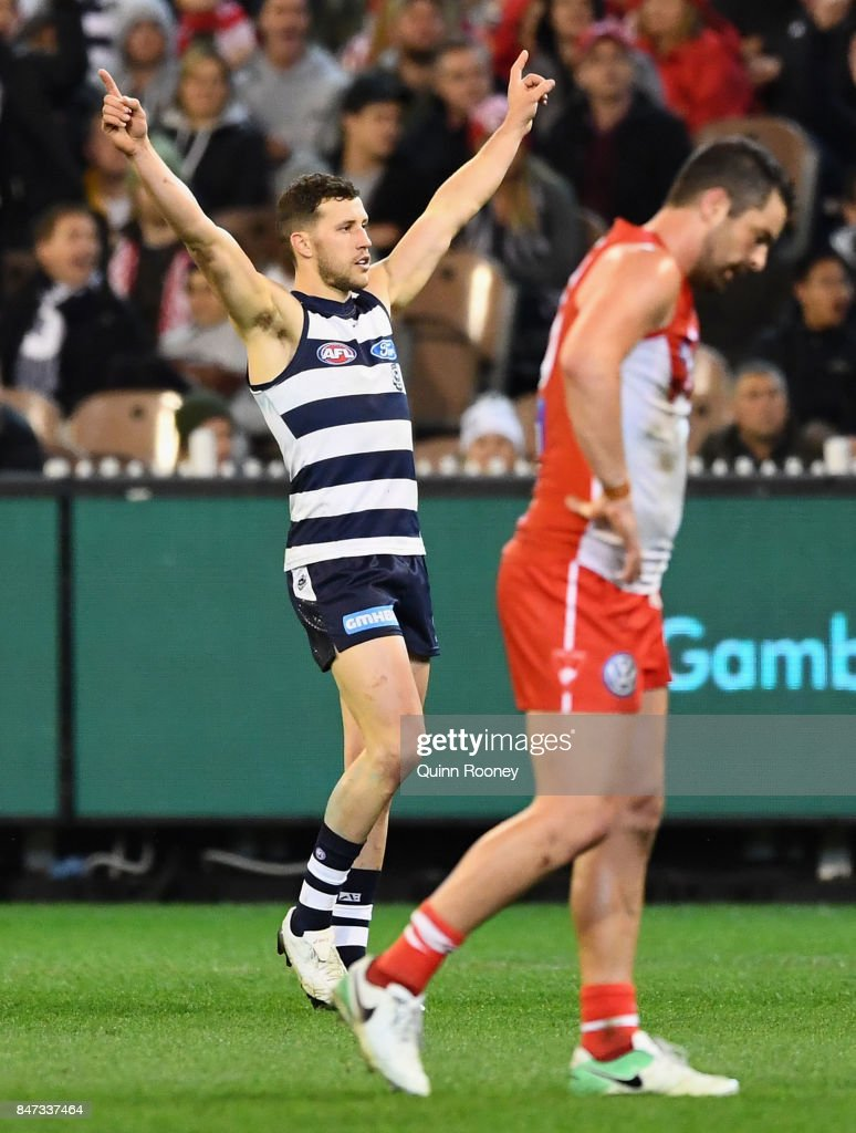 Sam Menegola of the Cats celebrates kicking a goal during the Second Semi Final AFL match between the Geelong Cats and the Sydney Swans at Melbourne Cricket Ground on September 15, 2017 in Melbourne, Australia.