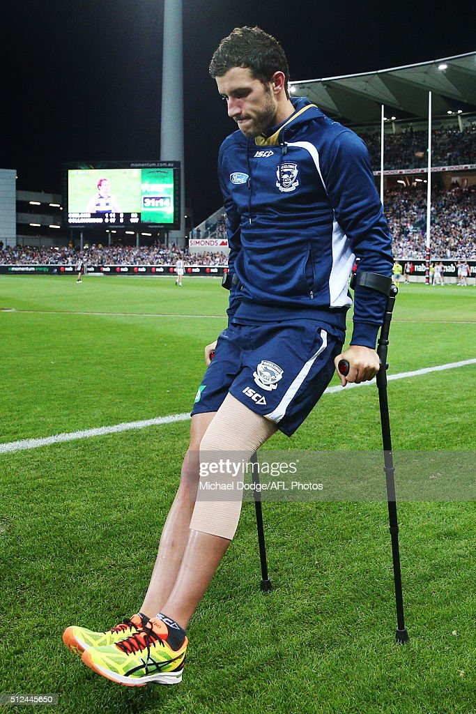 Sam Menegola of the Cats walk off on crutches after sustaininig a leg injury during the 2016 NAB Challenge match between the Geelong Cats and the Collingwood Magpies at Simonds Stadium on February 26, 2016 in Geelong, Australia.