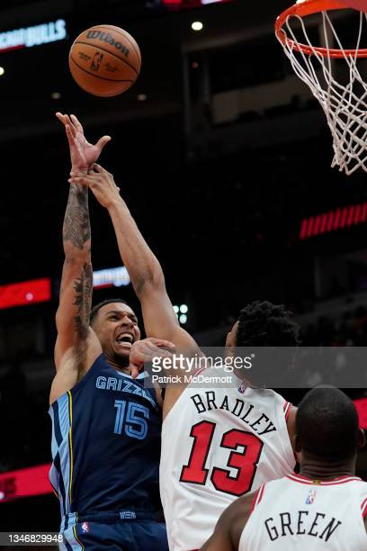 Sam Merrill of the Memphis Grizzlies shoots the ball against Tony Bradley of the Chicago Bulls in the second half during a preseason game at United...