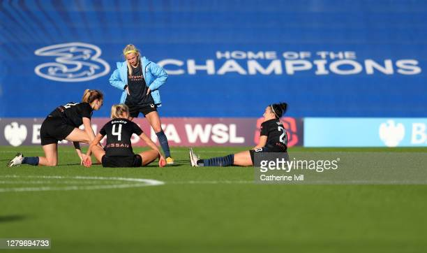 Sam Mewis Chloe Kelly Gemma Bonner and Lucy Bronze of Manchester City sit on the pitch following the Barclays FA Women's Super League match between...