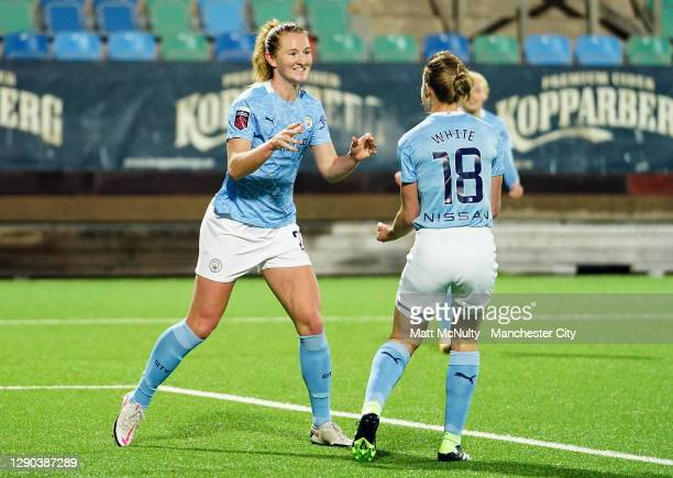 Sam Mewis of Manchester City celebrates with Ellen White after scoring her teams second goal during the UEFA Women's Champions League Round of 32...