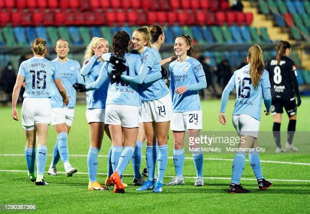 Sam Mewis of Manchester City celebrates with teammates after scoring her teams second goal during the UEFA Women's Champions League Round of 32 First...