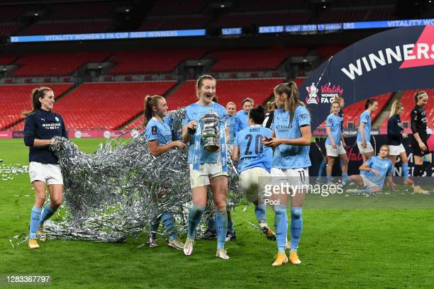 Sam Mewis of Manchester City celebrates with the Vitality Women's FA Cup Trophy following her team's victory in the Vitality Women's FA Cup Final...