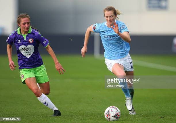 Sam Mewis of Manchester City Women beats Naomi Layzell of Bristol City Women during the Barclays FA Women's Super League match between Manchester...
