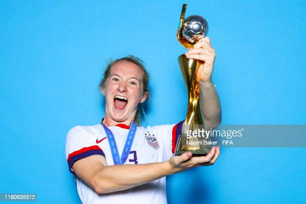 Sam Mewis of the USA poses with the Women's World Cup trophy after the 2019 FIFA Women's World Cup France Final match between The United State of...