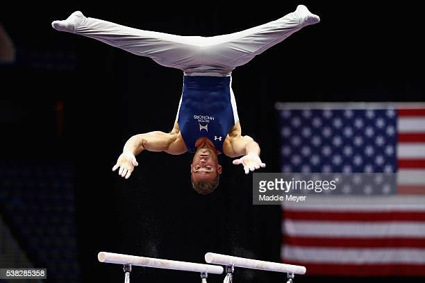 Sam Mikulak competes on the parallel bars during the 2016 Men's PG Gymnastics CHampionships at the XL Center on June 5 2016 in Hartford Connecticut